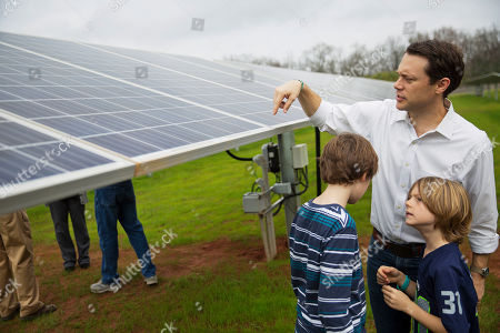 Stock Image of Thomas Carter, Henry Carter, Jason Carter Jason Carter, the grandson of former President Jimmy Carter, explains how solar panels work to sons Thomas, right, and Henry, left, following a ribbon cutting ceremony for a solar panel project on farmland Jimmy Carter owns in his hometown of Plains, Ga., . Jimmy Carter leased the land to Atlanta-based SolAmerica Energy, which owns, operates, and sells power generated from solar cells. The company estimates the project will provide more than half of the power needed in this town of 755 people