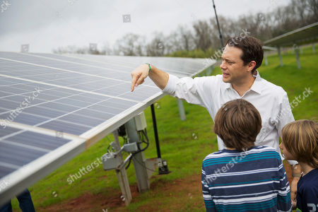 Thomas Carter, Henry Carter, Jason Carter Jason Carter, the grandson of former President Jimmy Carter, explains how solar panels work to sons Thomas, 8, right, and Henry, 10, left, following a ribbon cutting ceremony for a solar panel project on farmland Jimmy Carter owns in his hometown of Plains, Ga., . Jimmy Carter, who is 92, leased the land to Atlanta-based SolAmerica Energy, which owns, operates, and sells power generated from solar cells. The company estimates the project will provide more than half of the power needed in this town of 755 people