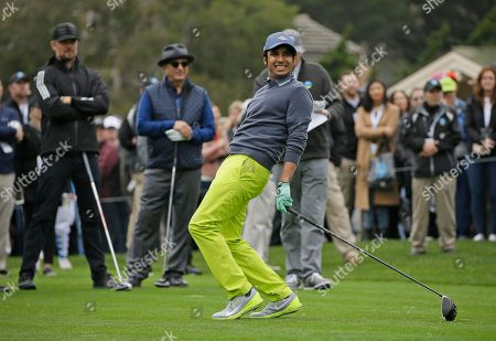 Kunal Nayar, Josh Duhamel, Andy Garcia Kunal Nayar, right, follows his drive from the first tee as Josh Duhamel, left, and Andy Garcia, center, watch in the background during the celebrity challenge event of the AT&T Pebble Beach National Pro-Am golf tournament, in Pebble Beach, Calif