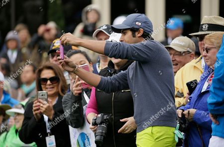 Stock Picture of Kunal Nayar takes a selfie with fans on the first tee during the celebrity challenge event of the AT&T Pebble Beach National Pro-Am golf tournament, in Pebble Beach, Calif