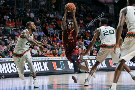 Chris Clarke, Kamari Murphy, Dewan Huell Virginia Tech's Chris Clarke (15) drives to the basket as Miami's Kamari Murphy (21) and Dewan Huell (20) defend during the first half of an NCAA basketball game, in Coral Gables, Fla