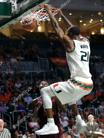 Kamari Murphy, Chris Clarke Miami's Kamari Murphy (21) dunks over Virginia Tech's Chris Clarke during the second half of an NCAA basketball game, in Coral Gables, Fla. Miami defeated Virginia Tech 74-68