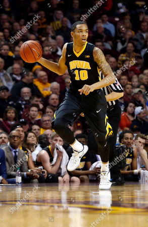 Iowa's Christian Williams plays against Minnesota during the first half of an NCAA college basketball game, in Minneapolis