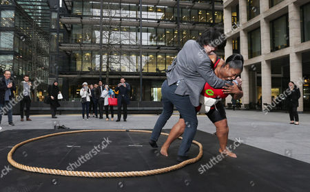 Sumo wrestler Sharran Alexander teams up with Groupon to wrestle City workers in celebration of Japan's National Foundation Day on Saturday