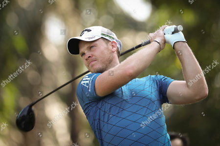 Danny Willet of England follows his shot on the sixteenth hole during the first day of Maybank Championship golf tournament in Kuala Lumpur, Malaysia on