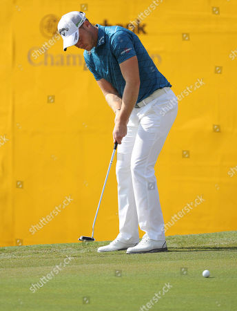 Danny Willet of England plays a putt on the eighteenth hole during the first day of the Maybank Championship golf tournament in Kuala Lumpur, Malaysia, on