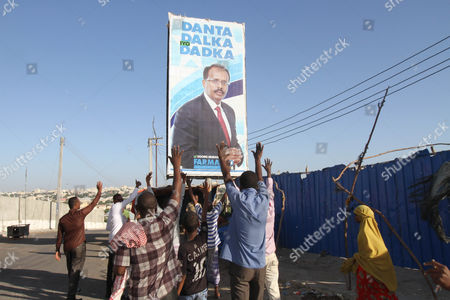 Supporters of newly elected President of Somalia Mohamed Abdullahi 'Farmajo' Mohamed celebrate in the streets after the votes where counted in the presidential election held at the international airport in Mogadishu, Somalia, 09 February 2017. Members of the upper and lower houses voted with 21 candidates for president. The war torn country is holding its first Presidential elections in a quarter century.