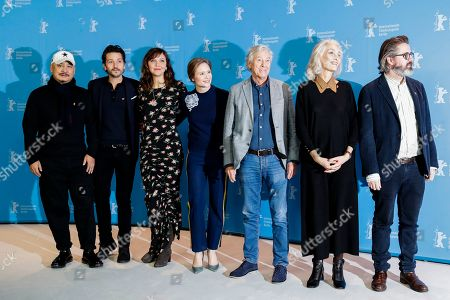 The Jury of the 67th International Berlin Film Festival, from left: Wang Quan'an, Diego Luna, Maggie Gyllenhaal, Julia Jentsch, Paul Verhoeven, Dora Bouchoucha Fourati and Olafur Eliasson pose for a group photo during a photo call at the 2017 Berlinale Film Festival in Berlin, Germany