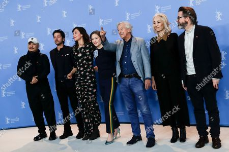 The Jury of the 67th International Berlin Film Festival, from left, Wang Quan'an, Diego Luna, Maggie Gyllenhaal, Julia Jentsch, Paul Verhoeven, Dora Bouchoucha Fourati and Olafur Eliasson pose for a group photo during a photo call at the 2017 Berlinale Film Festival in Berlin, Germany