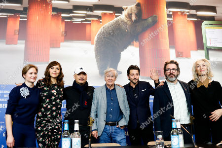 The Jury of the 67th International Berlin Film Festival, from left, Julia Jentsch, Maggie Gyllenhaal, Wang Quan'an, Paul Verhoeven, Diego Luna, Olafur Eliasson and Dora Bouchoucha Fourati pose for a group photo after a news conference at the 2017 Berlinale Film Festival in Berlin, Germany