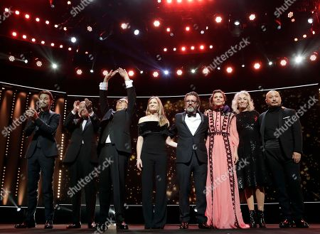 From left, jury members Diego Luna, Paul Verhoeven, festival director Dieter Kosslick, Julia Jentsch, Olafur Eliasson, Maggie Gyllenhaal, Dora Bouchoucha Fourati and Wang Quan'an attend the opening gala of the 2017 Berlinale Film Festival in Berlin, Germany
