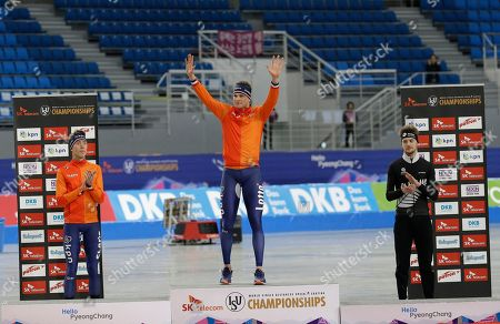 Sven Kramer, Jorrit Bergsma, Peter Michael Winner Sven Kramer, center, of the Netherlands waves on the podium as second placed his countryman Jorrit Bergsma and third placed Peter Michael of New Zealand, right, stand during an award ceremony of the men's 5,000-meter race of the ISU world single distances speed skating championships at Gangneung Oval in Gangneung, South Korea, . The world cup competition is also a test event for the upcoming 2018 PyeongChang Winter Olympics