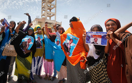 Somalis celebrate and hold banners of newly elected Somali President Mohamed Abdullahi Farmajo in the capital Mogadishu, Somalia . Former prime minister Farmajo who holds dual Somali-U.S. citizenship was declared Somalia's new president Wednesday, immediately taking the oath of office as the long-chaotic country moved toward its first fully functioning central government in a quarter-century