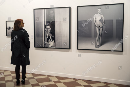 A visitor looks at a photograph by Swiss artist Michel Comte depicting Italian-French model Carla Bruni (R) during the press preview of the exhibition 'Michael Comte. Portraits' at La Termica contemporary art center in Malaga, southeastern Spain, 09 February 2017. The exhibition will run from 10 February to 14 May 2017.