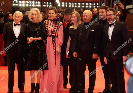 The jury, from left, President Paul Verhoeven, Dora Bouchoucha Fourati, Maggie Gyllenhaal, Dieter Kosslick, Julia Jentsch Wang Quan'an, Diego Luna and Olafur Eliasson pose on the red carpet for the opening film 'Django' at the 2017 Berlinale Film Festival in Berlin, Germany