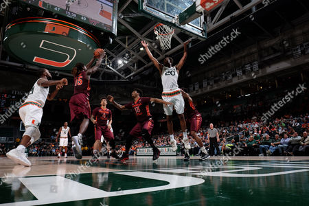 Chris Clarke #15 of Virginia Tech out rebounds Kamari Murphy #21 and Dewan Huell #20 of Miami during the NCAA basketball game between the Miami Hurricanes and the Virginia Tech Hokies in Coral Gables, Florida. The 'Canes defeated the Hokies 74-68