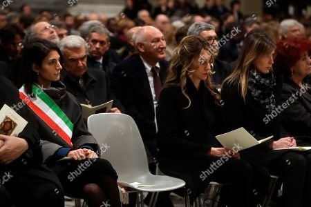 Rome's Mayor Virginia Raggi, left, sits next to Minister of Public Administration and Simplification, Marianna Madia, cabinet Undersecretary Maria Elena Boschi and Education Minister Valeria Fedeli, right, as she follows an eucharistic liturgy, at the St. John in Latheran Basilica, in Rome