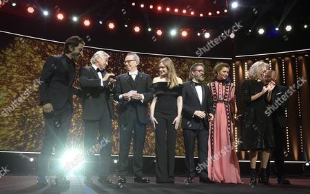 Stock Image of Festival Jury members (L-R) Diego Luna, Paul Verhoeven, Festival director Dieter Kosslick, Julia Jentsch, Olafur Eliasson, Maggie Gyllenhaal, Dora Bouchoucha Fourati and Wang Quan An attend the opening ceremony of the 67th annual Berlin Film Festival and the premiere of 'Django', in Berlin, Germany, 09 February 2017. Presented in the official competition, the movie opens the Berlinale festival which runs from 09 to 19 February.