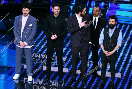 Italian host Carlo Conti (2-R) with Italian singers Leonardo Lamacchia (L), Lele (2-L), Maldestro (C) and Francesco Guasti (R) on stage during the 67th Festival of the Italian Song of Sanremo at the Ariston theater in Sanremo, Italy, 10 February 2017. The 67th edition of the television song contest runs from 07 to 11 February.