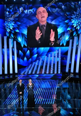 Italian actor Maurizio Crozza on the screen and Italian hosts Carlo Conti and Maria De Filippi on stage during the 67th Festival of the Italian Song of Sanremo at the Ariston theater in Sanremo, Italy, 10 February 2017. The 67th edition of the television song contest runs from 07 to 11 February.