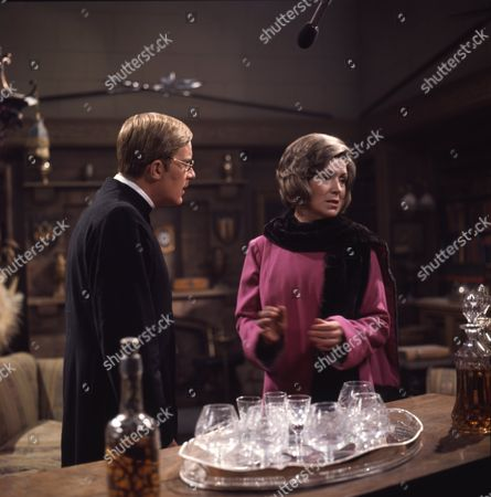 Veronica Hurst (as Lady Jane Flaxton) and Nicholas Pennell (as the Vicar)