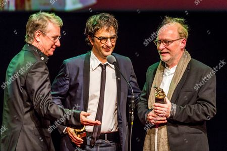 Director Paul Sarossy (r) and Operator Atom Egoyan (c) of Canada Received the Award For the Directing Duo-operator at the Hands of Festival Director Marek Zydowicz (l) During a Gala Closing of the 24th Festival of the Art of Cinematography Camerimage at the Opera Nova in Bydgoszcz Poland 19 November 2016 Poland Bydgoszcz