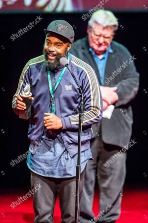 Stock Photo of Operator Bradford Young (l) with the Silver Frog Award For the Film 'New Beginning' During a Gala Closing of the 24th Festival of the Art of Cinematography Camerimage at the Opera Nova in Bydgoszcz Poland 19 November 2016 Poland Bydgoszcz
