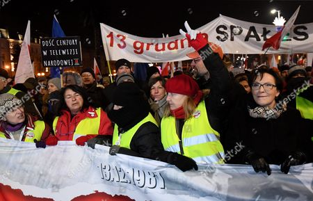 Former Polish Pm Ewa Kopacz (r) with Other Demonstrators Take Part in the 'Stop Devastation of Poland' March Organized by the Committee For the Defence of Democracy (kod) on the 35th Anniversary of the Introduction of Martial Law in Poland in Warsaw Poland 13 December 2016 the March is Organized to Protest Against the Polish Government of Law and Justice Party (pis) the Symbolic Date of the 13th of December Relates to the Introduction of the Martial Law in Poland in 1981 As the Organizers Say: the Fight to Preserve the Democratic State of Law is a Tribute to the Victims of the Martial Law Poland Warsaw