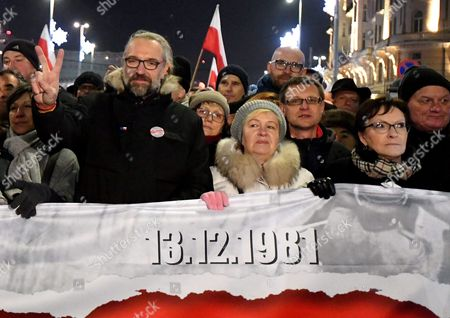 Former Polish Pm Ewa Kopacz (r) and the Committee For the Defence of Democracy (kod) Leader Mateusz Kijowski (l) with Other Demonstrators Take Part in the 'Stop Devastation of Poland' March Organized by the Committee For the Defence of Democracy (kod) on the 35th Anniversary of the Introduction of Martial Law in Poland in Warsaw Poland 13 December 2016 the March is Organized to Protest Against the Polish Government of Law and Justice Party (pis) the Symbolic Date of the 13th of December Relates to the Introduction of the Martial Law in Poland in 1981 As the Organizers Say: the Fight to Preserve the Democratic State of Law is a Tribute to the Victims of the Martial Law Poland Warsaw