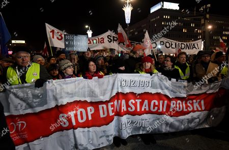 Former Polish Pm Ewa Kopacz (4-r) and the Committee For the Defence of Democracy (kod) Leader Mateusz Kijowski (6-r) with Other Demonstrators Take Part in the 'Stop Devastation of Poland' March Organized by the Committee For the Defence of Democracy (kod) on the 35th Anniversary of the Introduction of Martial Law in Poland in Warsaw Poland 13 December 2016 the March is Organized to Protest Against the Polish Government of Law and Justice Party (pis) the Symbolic Date of the 13th of December Relates to the Introduction of the Martial Law in Poland in 1981 As the Organizers Say: the Fight to Preserve the Democratic State of Law is a Tribute to the Victims of the Martial Law Poland Warsaw