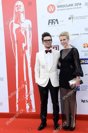 Stock Image of Polish Director Tomasz Wasilewski (l) and Polish Actress Julia Kijowska (r) Arrive on the Red Carpet at the European Film Awards in Wroclaw Poland 10 December 2016 the Awards Are Presented Annually by the European Film Academy to Recognize Excellence in European Cinematic Achievements Poland Wroclaw