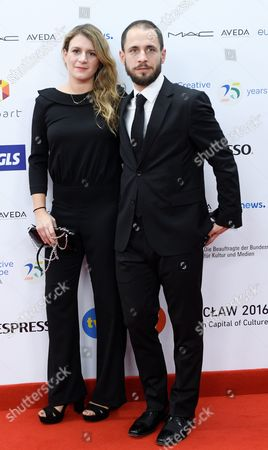 Stock Image of The Creators of the Film 'El Adios' Director Clara Roquet (l) and Producer Sergi Moreno (r) Arrive on the Red Carpet at the European Film Awards in Wroclaw Poland 10 December 2016 the Awards Are Presented Annually by the European Film Academy to Recognize Excellence in European Cinema Poland Wroclaw