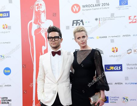 Stock Picture of Polish Director Tomasz Wasilewski (l) and Polish Actress Julia Kijowska (r) Arrive on the Red Carpet at the European Film Awards in Wroclaw Poland 10 December 2016 the Awards Are Presented Annually by the European Film Academy to Recognize Excellence in European Cinematic Achievements Poland Wroclaw