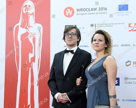 Stock Photo of Polish Sound Producer Radoslaw Ochnio with and His Unidentified Partner Arrive on the Red Carpet at the European Film Awards in Wroclaw Poland 10 December 2016 the Awards Are Presented Annually by the European Film Academy to Recognize Excellence in European Cinematic Achievements Poland Wroclaw