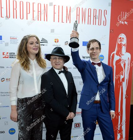 Stock Photo of The Creators of the European Short Film of the Year '9 Days - From My Window in Aleppo': Directors Thomas Vroege (r) and Floor Van Der Meulen (l) and Operator Issa Touma (c) After the 29th European Film Awards Ceremony in Wroclaw Poland 10 December 2016 the Awards Are Presented Annually by the European Film Academy to Recognize Excellence in European Cinema Poland Wroclaw
