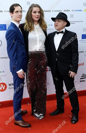 Stock Image of Dutch Filmmakers Thomas Vroege (l) Floor Van Der Meulen (r) and Syrian Photographer Issa Touma (c) Arrive on the Red Carpet For the 29th European Film Awards Ceremony in Wroclaw Poland 10 December 2016 the Awards Are Presented Annually by the European Film Academy to Recognize Excellence in European Cinema Poland Wroclaw