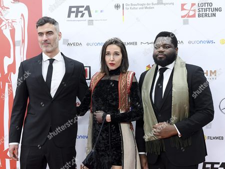 The Creators of the Film 'Home' (l-r): British Director Daniel Mulloy and Producers: Arta Dobroshi From Kosovar and Afolabi Kuti From Britain Arrive on the Red Carpet at the European Film Awards in Wroclaw Poland 10 December 2016 the Awards Are Presented Annually by the European Film Academy to Recognize Excellence in European Cinema Poland Wroclaw