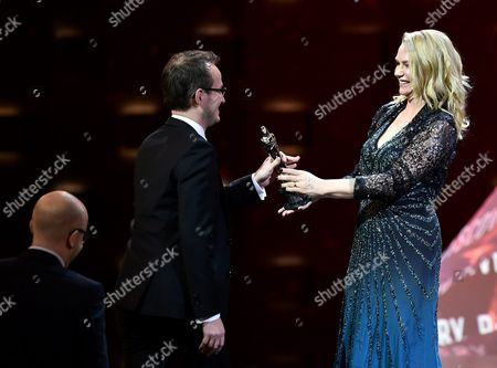 Stock Picture of Swedish Actress Malin Levanon (r) Presents the European Discovery - Prix Fipresci Award For the Film 'The Happiest Day in the Life of Olli Maki' to Finnish Director Juho Kuosmanen (c) During the 29th European Film Awards Ceremony in Wroclaw Poland 10 December 2016 the Awards Are Presented Annually by the European Film Academy to Recognize Excellence in European Cinema Poland Wroclaw