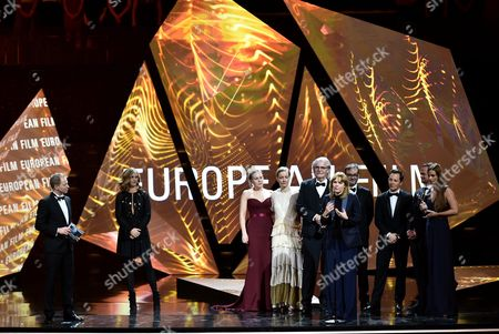 The Creators of the European Film of the Year 'Toni Erdmann': Actress Hadewych Minis (3-l) Sandra Hueller (4-l) Actor Peter Simonischek (5-l) Director Maren Ade (5-r) Producer Michel Merkt (4-r) Actor Trystan Puetter (3-r) and Producers Jonas Dornbach (2-r) and Janine Jackowski (r) Accompanied with the Host of the Gala Maciej Stuhr (l) and Belgian Actress Cecile De France (2-l) on Stage During the 29th European Film Awards Ceremony in Wroclaw Poland 10 December 2016 the Awards Are Presented Annually by the European Film Academy to Recognize Excellence in European Cinema Poland Wroclaw