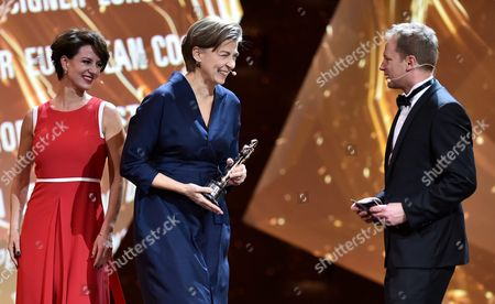 Stock Image of Stefanie Bieker Accepts the European Costume Designer 2016 Award For Her Work in the Film 'Land of Mine' While Polish Host of the European Film Awards Gala Maciej Stuhr (r) and Polish Actress Maja Ostaszewska (l) Watch on During the European Film Awards in Wroclaw Poland 10 December 2016 the Awards Are Presented Annually by the European Film Academy to Recognize Excellence in European Cinema Poland Wroclaw
