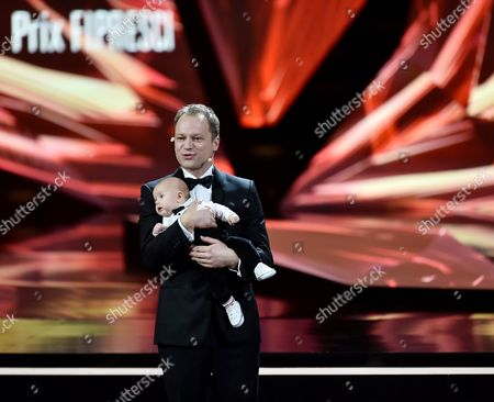 Polish Actor and the Host of the European Film Awards Gala Maciej Stuhr with His Son Tadeusz on Stage During the 29th European Film Awards Ceremony in Wroclaw Poland 10 December 2016 the Awards Are Presented Annually by the European Film Academy to Recognize Excellence in European Cinema Poland Wroclaw