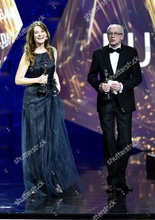 Stock Photo of Danish Editors Janus Billeskov Jansen (r) and Anne Osterud (l) on Stage After Being Honored with the European Editor 2016 Award For Their Work on the Film 'Commune' During the 29th European Film Awards Ceremony in Wroclaw Poland 10 December 2016 the Awards Are Presented Annually by the European Film Academy to Recognize Excellence in European Cinema Poland Wroclaw