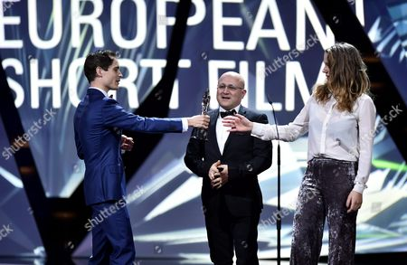 Stock Photo of Dutch Filmmakers Thomas Vroege (l) Floor Van Der Meulen (r) and Syrian Photographer Issa Touma (c) Are Honored with the Award For the Best European Short Film For the Film '9 Days From My Window in Aleppo' During the 29th European Film Awards Ceremony in Wroclaw Poland 10 December 2016 the Awards Are Presented Annually by the European Film Academy to Recognize Excellence in European Cinema Poland Wroclaw