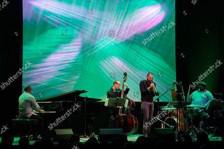 Israeli Trumpeter Avishai Cohen (2r) and Double Bassist Yoni Zelnik (2l) Performs on Stage During a Concert Avishai Cohen Quartet As Part of Jazz Jantar Festival 2016 in Gdansk Poland 10 November 2016 Poland Gda±sk