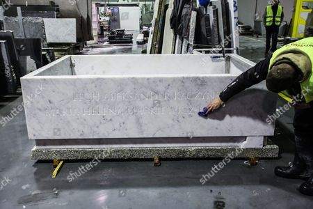 Workers Put Finishing Touches to the New Sarcophagus of the Presidential Couple Lech Kaczynski and Maria Kaczynska in Slopsk Central Poland 17 November 2016 Sarcophagus of the Presidential Couple Must Be Replaced After the Exhumation Which was Conducted on 14 November 2016 the Design of the Previous Sarcophagus Did not Provide a Multiple Opening the New Sarcophagus is Made of Carrara Marble-white with Delicate Veins Polish Emblem the Cross and the Dates of Birth and Death of the Presidential Couple Will Be the New Elements That Will Appear on the Sarcophagus the Authors of the Project of the New Sarcophagus is Architect Marta Witoslawska and Warsaw Sculptor Marek Moderau Poland Slopsk