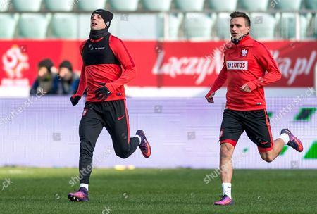 Polish National Soccer Team Players Kamil Grosicki (l) and Slawomir Peszko (r) Warm-up During Their Team's Training Session in Wroclaw Poland 13 November 2016 Poland Will Play an International Friendly Soccer Match Against Slovenia on 14 November 2013 in Wroclaw Poland Wroclaw