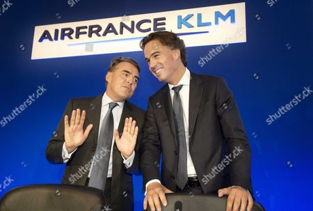Ceo of Airline Company Air France-klm Alexandre De Juniac (l) and Klm Ceo Camiel Eurlings (r) Talk During a Press Conference About the Group's Half Year Results in Paris France 25 July 2014 the Ceo's Stated That the Group Has Lowered Its Loss in the First Half of 2014 France Paris