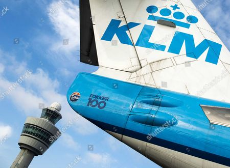 The Tail of a Royal Dutch Airways (klm) Aircraft Sits in Front of a Control Tower at Schiphol Airport Near Amsterdam the Netherlands 16 October 2014 Camiel Eurlings Has Resigned As Ceo of Klm and Will Be Succeeded by His Deputy Pieter Elbers Though the Company Has So Far not Made a Statement As to the Cause of Eurlings Departure Eurling Has Stated That the 500m Costs of the Strikes Recently Experienced by Air France a Company with Which Klm Merged in 2004 Should not Be Paid by Klm Which Has Consistently Outperformed Air France Netherlands Schipol