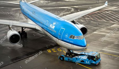 A Royal Dutch Airways (klm) Aircraft is Toed Across the Tarmac at Schiphol Airport Near Amsterdam the Netherlands 16 October 2014 Camiel Eurlings Has Resigned As Ceo of Klm and Will Be Succeeded by His Deputy Pieter Elbers Though the Company Has So Far not Made a Statement As to the Cause of Eurlings Departure Eurling Has Stated That the 500m Costs of the Strikes Recently Experienced by Air France a Company with Which Klm Merged in 2004 Should not Be Paid by Klm Which Has Consistently Outperformed Air France Netherlands Schipol