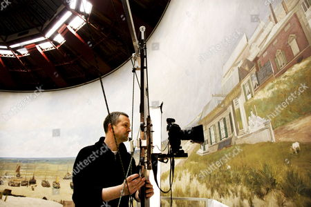 Photographer Bob Strik Takes Digital Pictures in a Very High Resolution of Details the Panorama Mesdag in the Hague Netherlands 03 March 2009 the Painting Will Completely Be Digitalised in Pictures by August 2010 Panorama Mesdag is a Cylindrical Painting More Than 14 Meters High and 120 Meters in Circumference the Vista of the Sea the Dunes and Scheveningen Village was Painted by One of the Most Famous Painters of the Hague School Hendrik Willem Mesdag It is the Oldest 19th Century Panorama in the World in Its Original Site and a Unique Cultural Heritage Netherlands the Hague